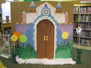 Doors to lifesize Candyland, decorated with lollipops and candy canes