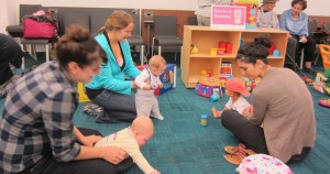 Caregivers and children playing at a Family PlayShop program at CLP-East Liberty